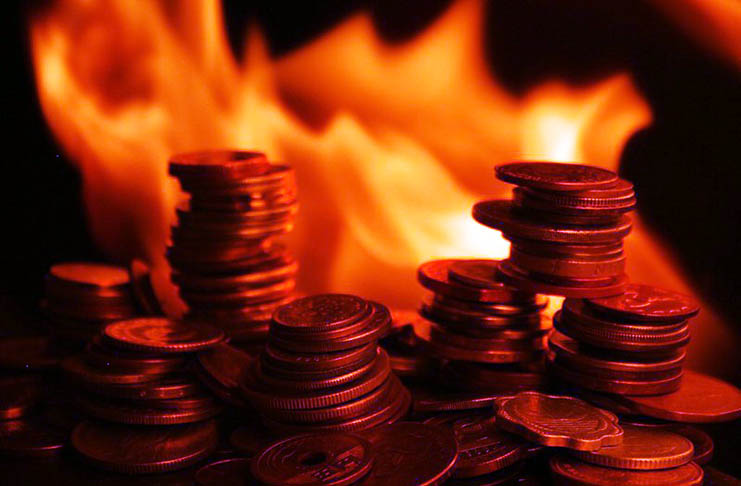 What is token burning and how does the crypto space benefit from it?